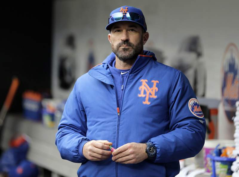 FILE - In this Sunday, April 28, 2019, file photo, then-New York Mets manager Mickey Callaway stands by the dugout before a baseball game against the Milwaukee Brewers at Citi Field, in New York. Callaway, former manager of the New York Mets and current Los Angeles Angels pitching coach, aggressively pursued several women who work in sports media and sent three of them inappropriate photos, The Athletic reported Monday, Feb. 1, 2021. (AP Photo/Seth Wenig, File)