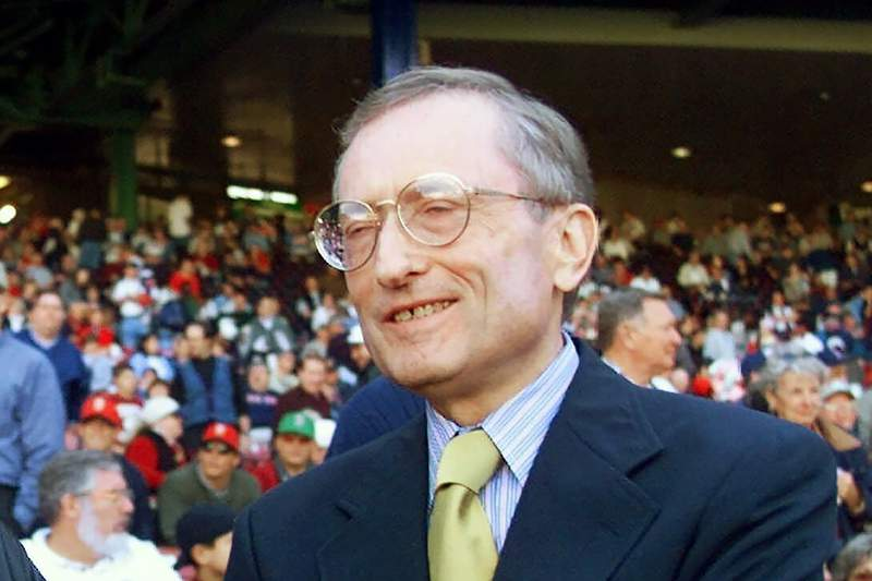 FILE - In this Oct. 16, 1999, file photo, American League President Gene Budig waits for the start of Game 3 of the American League Championship Series between the New York Yankees and Boston Red Sox, in Boston. Former American League president Gene Budig has died at age 81. The Charleston RiverDogs, which Budig co-owned, announced Budig's death on Tuesday, Sept. 8, 2020.(AP Photo/Elise Amendola, File)