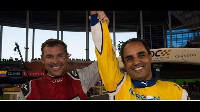 Juan Pablo Montoya (left) celebrates his Race of Champions victory over Tom Kristensen (left).