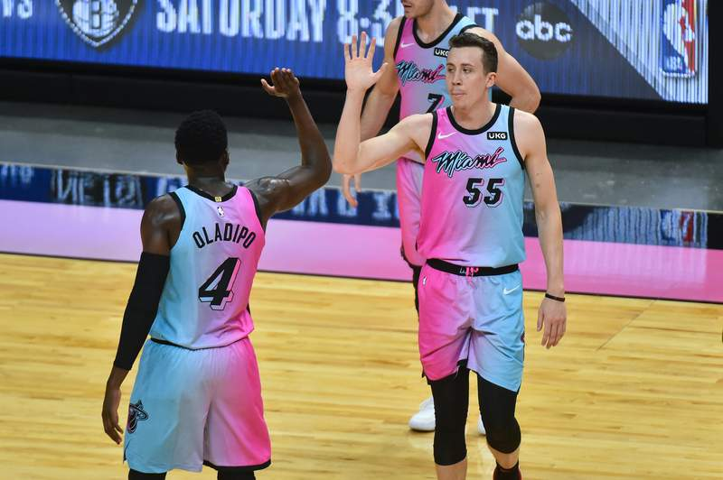 Duncan Robinson of the Miami Heat celebrates his three point basket with Victor Oladipo in the 4th quarter against the Los Angeles Lakers at American Airlines Arena on April 8, 2021 in Miami, Florida.