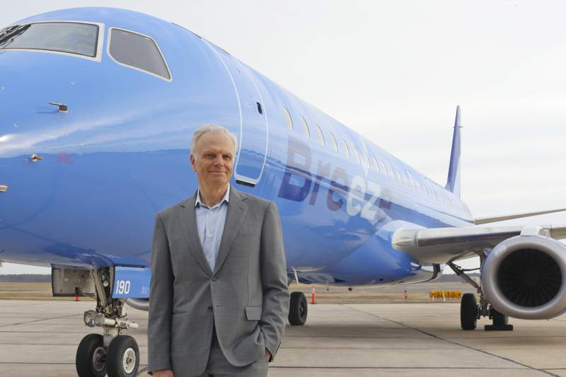 FILE - This file photo provided by CeanOrrett shows David Neeleman with Breeze aircraft.  Breeze Airways said Friday, May 21, 2021,  that it will begin flying May 27 and expand by July to 16 cities, mostly in the Southeast and central U.S. Breeze, the creation of JetBlue Airways founder David Neeleman, is targeting secondary cities that are largely overlooked or abandoned by bigger carriers. Neeleman says 95% of Breeze's early routes have no other nonstop flights. (CeanOrrett via AP, File)