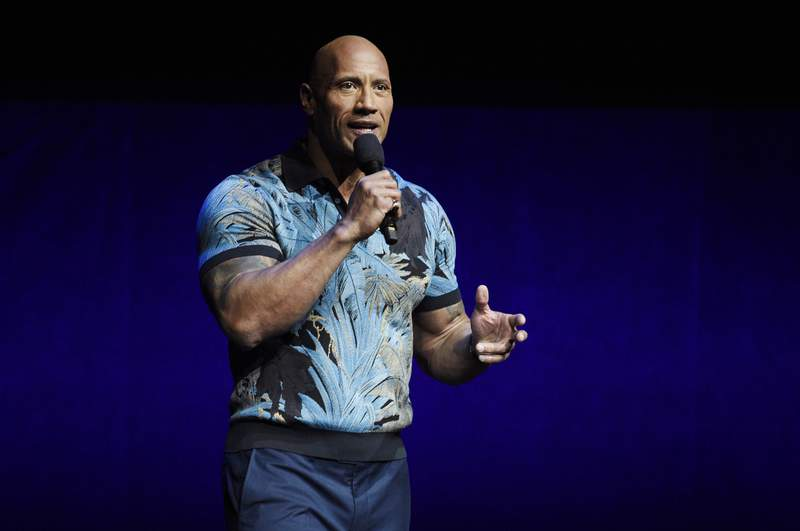 FILE - In this Wednesday, April 3, 2019, file photo, Dwayne Johnson speaks during the Universal Pictures presentation at CinemaCon 2019, the official convention of the National Association of Theatre Owners (NATO) at Caesars Palace, in Las Vegas. Johnson says he and his family tested positive for the coronavirus. Johnson announced their diagnosis in an 11-plus minute video on Instagram on Wednesday, Sept. 2, 2020. (Photo by Chris Pizzello/Invision/AP, File)