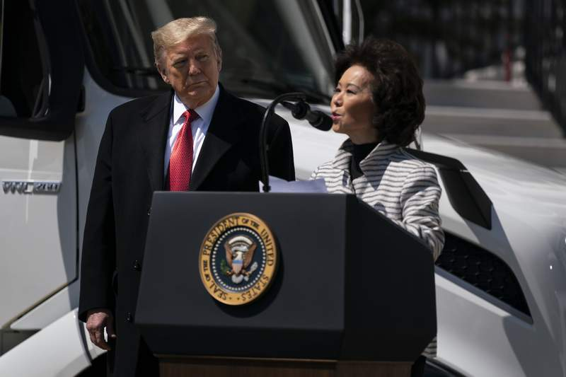 President Donald Trump listens as Secretary of Transportation Elaine Chao speaks during an event celebrating American truckers, at the White House, Thursday, April 16, 2020, in Washington. (AP Photo/Evan Vucci)