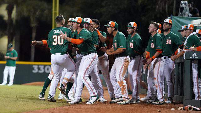 Miami Hurricanes first baseman Alex Toral celebrates with his teammates during a game last season in Coral Gables.