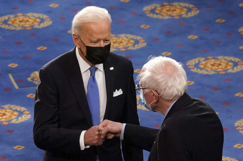 FILE - In this April 28, 2021 file photo, President Joe Biden greets Sen. Bernie Sanders, I-Vt., as Biden arrives to speak to a joint session of Congress  in the House Chamber at the U.S. Capitol in Washington. Many working-age people assume that Medicare covers just about every kind of health care that an older person may need. But it doesnt. Some of the biggest gaps involve dental, vision and hearing services. Now Democrats are trying to make those benefits a standard part of Medicare under massive legislation expected later this year to advance President Joe Bidens domestic agenda. Vermont Independent Sen. Bernie Sanders and other progressives are leading the push. (AP Photo/Andrew Harnik, Pool)