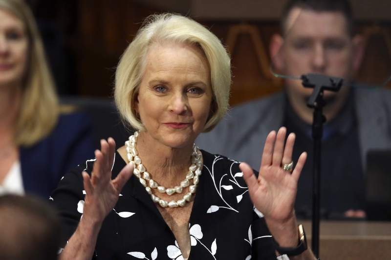 FILE - In this Jan. 13, 2020, file photo Cindy McCain, wife of former Arizona Sen. John McCain, waves to the crowd after being acknowledged by Arizona Republican Gov. Doug Ducey during his State of the State address on the opening day of the legislative session at the Capitol in Phoenix. Democratic presidential candidate former Vice President Joe Biden said Sept. 22 that Cindy McCain plans to endorse him for president. (AP Photo/Ross D. Franklin, File)