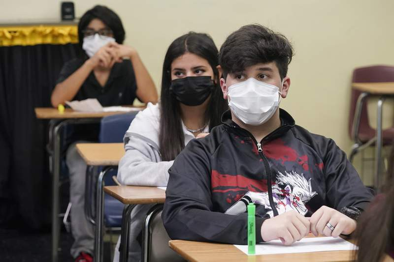 Students sit in an algebra class at Barbara Coleman Senior High School on the first day of school, Monday, Aug. 23, 2021, in Miami Lakes, Fla. Miami-Dade County public schools require students to wear a mask to prevent the spread of COVID-19.