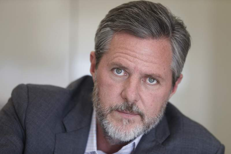 FILE - In this Nov. 16, 2016 file photo, Liberty University president Jerry Falwell Jr., poses during an interview in his offices at the school in Lynchburg, Va. Falwell filed a lawsuit Wednesday, Oct. 28, 2020, against Liberty University with defamation and breach of contract claims alleging the school damaged his reputation in statements after his resignation. (AP Photo/Steve Helber, File)