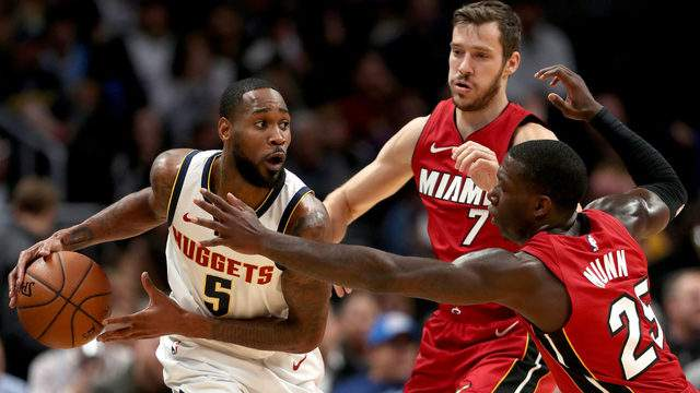 Will Barton III #5 of the Denver Nuggets is guarded by Goran Dragic #7 and Kendrick Nunn #25 of the Miami Heat. (Photo by Matthew Stockman/Getty Images)