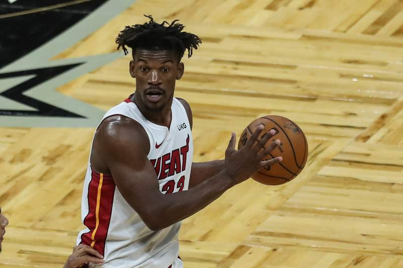 Jimmy Butler of the Miami Heat controls the ball against the Orlando Magic at Amway Center on March 14, 2021 in Orlando, Florida.