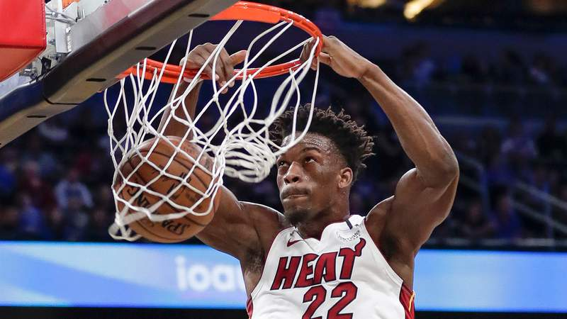 Miami Heat forward Jimmy Butler makes an uncontested dunk against the Orlando Magic during the first half of an NBA basketball game, Saturday, Feb. 1, 2020, in Orlando, Fla.