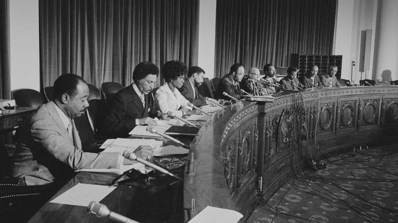 MAY 25, 1971: Congressional Black Caucus Representatives George W. Collins (D-Ill.), Ronald V. Dellums (D-Calif.), Shirley Chisholm (D-N.Y.), William L. Clay (D-Mo.), Charles C. Diggs, Jr. (D-Mich.), Augustus F. Hawkins (D-Calif.), Parren J. Mitchell (D-Md.), Walter Fauntroy (D-D.C.), Louis Stokes (D-Ohio), Ralph Metcalfe (D-Ill.) (Photo by Warren K. Leffler/Library of Congress).