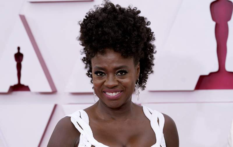 FILE - In this April 25, 2021 file photo, Viola Davis arrives at the Oscars at Union Station in Los Angeles.  Davis is working on a memoir her publisher calls deeply personal and brutally honest. HarperOne will release Davis Finding Me on April 19, 2022. Davis will trace her rise from growing up in poverty and family violence in Rhode Island to becoming one of the worlds most acclaimed actors.  (AP Photo/Chris Pizzello, Pool, File)