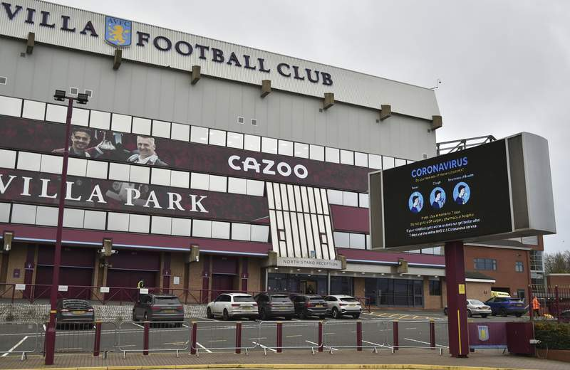 FILE - This Saturday, Nov. 21, 2020 file photo shows a general view of a social distancing message on display outside the Villa Park stadium, home of Aston Villa, in Birmingham, England. Aston Villa has on Thursday, Jan. 7, 2021 reported a significant coronavirus outbreak and closed its training ground a day before a scheduled FA Cup home game against Liverpool. Villa says discussions are ongoing between medical representatives of the club, the Football Association and the Premier League. (AP Photo/Rui Vieira, file)