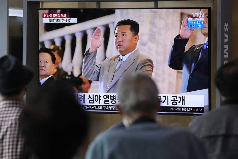 People watch a TV showing North Korean leader Kim Jong Un during a military parade held in Pyongyang, North Korea, at Seoul Railway Station in Seoul, South Korea, Thursday, Sept. 9, 2021. North Korea paraded goose-stepping soldiers and military hardware in its capital overnight in a celebration of the nation's 73rd anniversary, state media reported Thursday. (AP Photo/Ahn Young-joon)