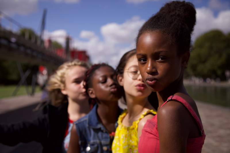 """This image released by Netflix shows the cast of the coming-of-age film """"Cuties,"""" streaming Wednesday, Sept. 9. (Netflix via AP)"""