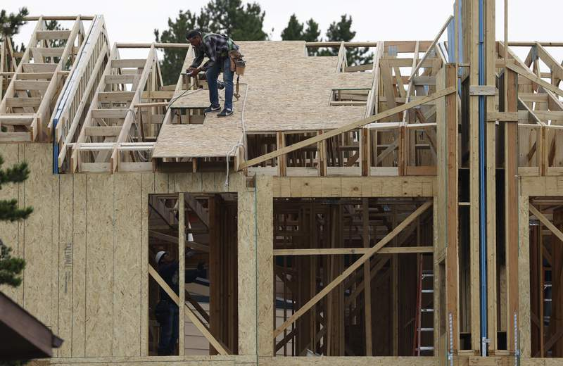 Workers toil on a multifamily dwelling Tuesday, Aug. 4, 2020, in Winter Park, Colo.   The Commerce Department reported Tuesday, Aug. 18, construction of new U.S. homes surged 22.6% last month as homebuilders continued to bounce back from the coronavirus pandemic.  (AP Photo/David Zalubowski)