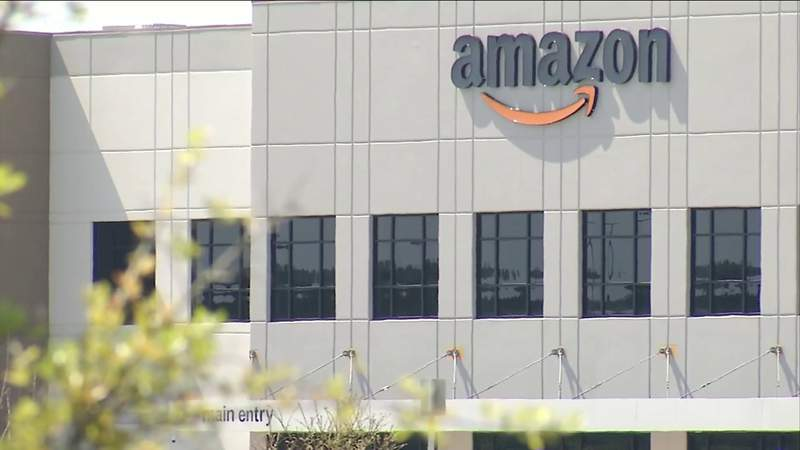 Officials say two suspects got out of a car, started shooting and then sped off outside a Jacksonville Amazon warehouse.