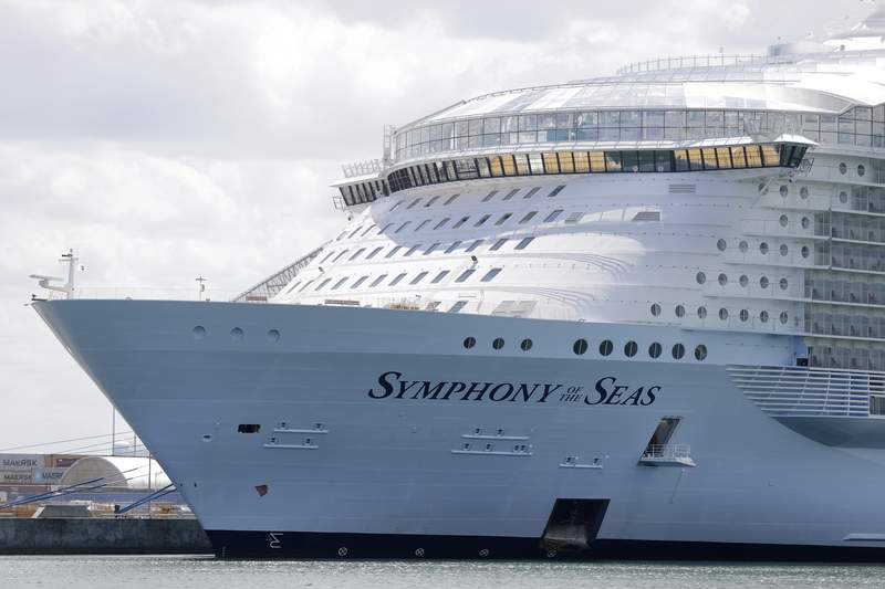FILE - The Symphony of the Seas cruise ship is shown docked at PortMiami, in a Wednesday, May 20, 2020, file photo, in Miami.Major cruise lines say they will test all passengers and crew for COVID-19 prior to boarding as part of their plan for resuming sailing in the Americas. The Cruise Lines International Association says its members will also require masks onboard and on shore excursions whenever physical distancing cant be maintained. No date has been set for the resumption of cruising in the Americas. The Centers for Disease Control and Prevention has a no-sail order for U.S. waters through Sept. 30. (AP Photo/Wilfredo Lee, File)