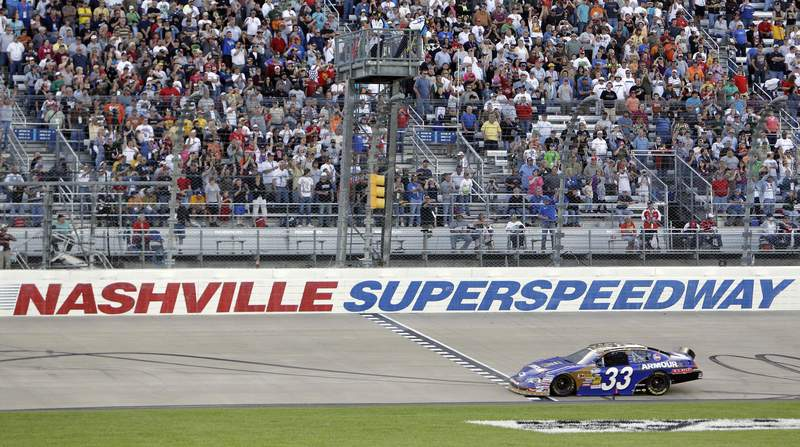 FILE -- In this April 3, 2010, file photo, Kevin Harvick takes the checkered flag at the finish line to win the NASCAR Nationwide Series Nashville 300 auto race at Nashville Superspeedway in Gladeville, Tenn. NASCAR is set to return to the track in 2021. Nashville Superspeedway will hold a Cup race for the first time next season.  It ends NASCARs decade-long drought at the track. (AP Photo/Mark Humphrey, File)