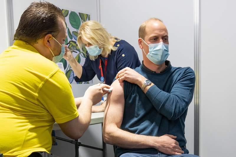 In this picture tweeted by the Duke and Duchess of Cambridge, Britain's Prince William receives his coronavirus vaccine in London, Tuesday, May 18, 2021. (Kensington Palace via AP)