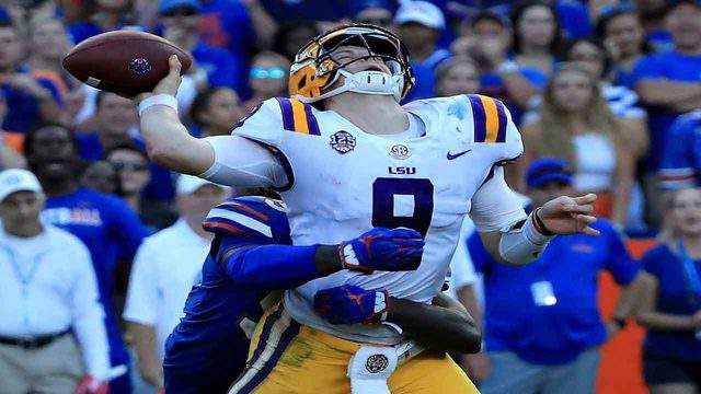 LSU Tigers quarterback Joe Burrow is tackled by Florida Gators linebacker Jachai Polite during a game at Steve Spurrier-Florida Field at Ben Hill Griffin Stadium, Oct. 6, 2018, in Gainesville, Florida.