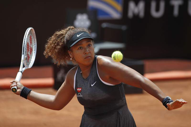 Naomi Osaka of Japan returns the ball to Jessica Pegula of the United States during their match at the Italian Open tennis tournament, in Rome, Wednesday, May 12, 2021. Osaka lost against Pegula 7-6, 6-2. (AP Photo/Alessandra Tarantino)