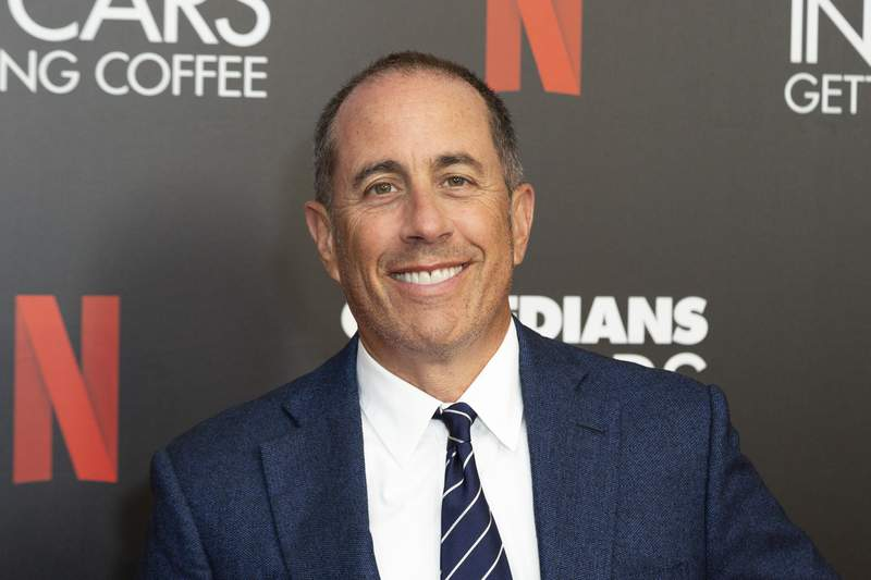 "FILE - This July 17, 2019 file photo shows Jerry Seinfeld at the ""Comedians In Cars Getting Coffee,"" photo call in Beverly Hills, Calif. Publisher Simon & Schuster announced that Seinfeld will release a book of comedy on October 6. (Photo by Willy Sanjuan/Invision/AP, File)"