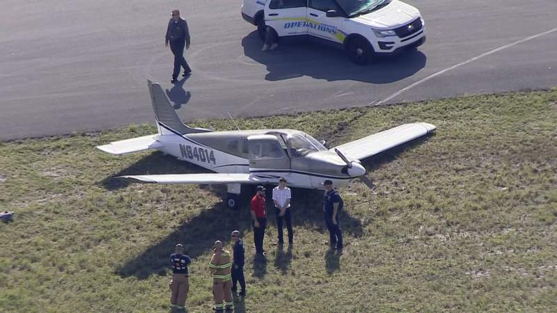 A small plane skidded off the runway at North Perry Airport after its landing gear collapsed.