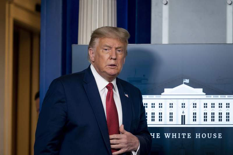 President Donald Trump arrives for a news conference in the James Brady Press Briefing Room at the White House, Monday, Aug. 10, 2020, in Washington. (AP Photo/Andrew Harnik)