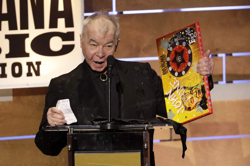 FILE - This Sept. 11, 2019 file photo shows John Prine accepting the Album of the Year award at the Americana Honors & Awards show in Nashville, Tenn. The Recording Academy has released a new recording of John Prines Angel From Montgomery with proceeds going to support the MusiCares COVID-19 Relief Fund. Prine died in April at age 73 from complications associated with the new coronavirus. (AP Photo/Wade Payne, File)