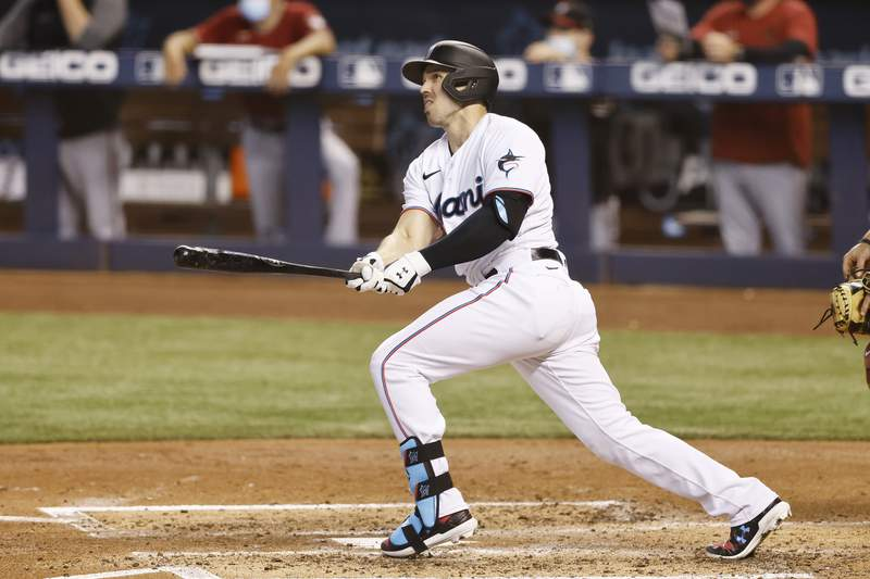 Adam Duvall of the Miami Marlins hits a three-run home run against the Arizona Diamondbacks during the second inning at loanDepot park on May 05, 2021 in Miami, Florida.