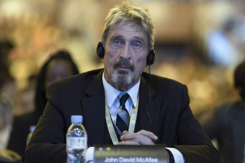 FILE - In this Tuesday, Aug. 16, 2016 file photo, founder of the first commercial anti-virus program that bore his name, John McAfee listens during the 4th China Internet Security Conference (ISC) in Beijing.  Detained antivirus software entrepreneur John McAfee has testified in a Spanish court as part of his fight against extradition to the United States. He is wanted by Tenessee on tax-related criminal charges that carry prison sentences of up to 30 years. McAfee, 75, appeared from prison via videolink at a hearing Tuesday, June 15, 2021 in Spains National Court. (AP Photo/Ng Han Guan, File)