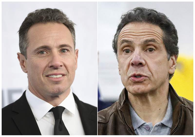 FILE - This combination file photo shows CNN news anchor Chris Cuomo at the WarnerMedia Upfront in New York on May 15, 2019, left, and New York Gov. Andrew Cuomo speaking during a news conference in New York on March 23, 2020. CNN host Chris Cuomo told viewers on Monday, March 1, 2021, that he obviously could not cover the charges against his older brother, New York Gov. Andrew Cuomo. New York's leader has been accused of sexual harassment by two women who work in state government. But Chris Cuomo said he understands CNN has to cover it, and said he cares profoundly about the issues brought up by the women who have accused his brother. (AP Photo/File)