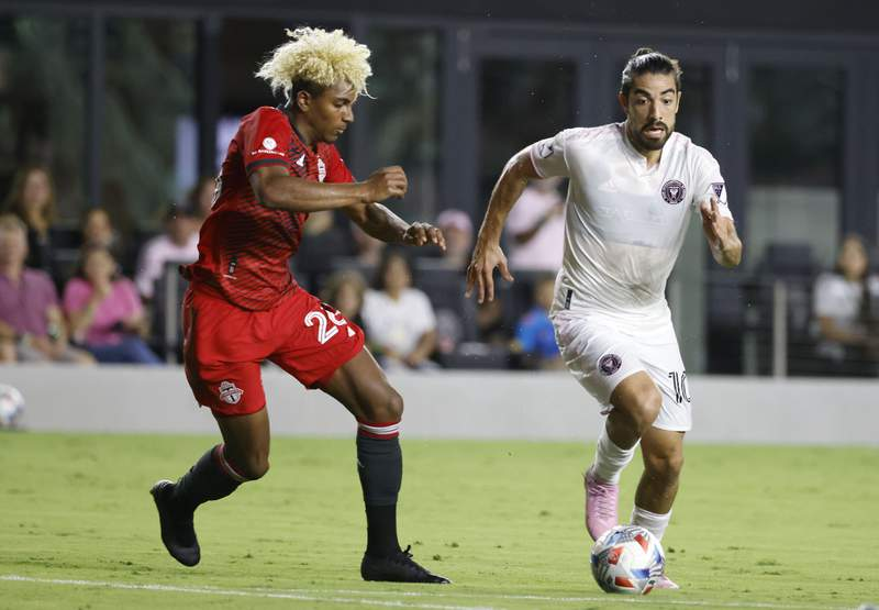 Inter Miami midfielder Rodolfo Pizarro moves the ball past Toronto FC defender Luke Singh during the first half of an MLS soccer match Saturday, Aug. 21, 2021, in Fort Lauderdale, Fla.
