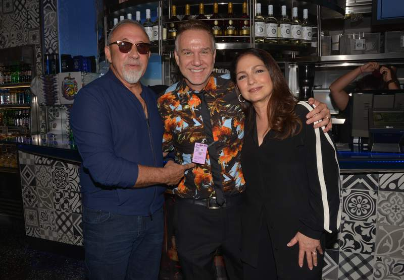 Emilio Estefan, Frank Amadeo and Gloria Estefan at the ribbon cutting at Estefan Kitchen Express at Miami International Airport on August 12, 2016 in Miami, Florida.