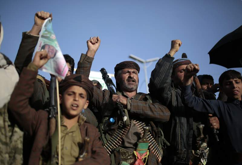 In this Jan. 25, 2021 photo, Houthi supporters chant slogans as they attend a demonstration against the United States over its decision to designate the Houthis a foreign terrorist organization in Sanaa, Yemen. President Joe Biden is distancing himself from Saudi Arabia's rulers over their war in Yemen and rights abuses. That includes Biden announcing Feb. 4, 2021, he would make good on a campaign pledge to cut U.S. support for a five-year Saudi-led military campaign in neighboring Yemen.  (AP Photo/Hani Mohammed)