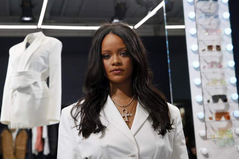 FILE - Rihanna poses as she unveils her first fashion designs for Fenty at a pop-up store in Paris, France, on May 22, 2019. LVMH Mot Hennessy Louis Vuitton, the worlds largest luxury group, has put Rihannas Fenty fashion collection on hold. The move, confirmed by LVMH Wednesday, comes nearly two years after the fashion conglomerate announced the collaboration with the pop artist and business mogul.  (AP Photo/Francois Mori, File)