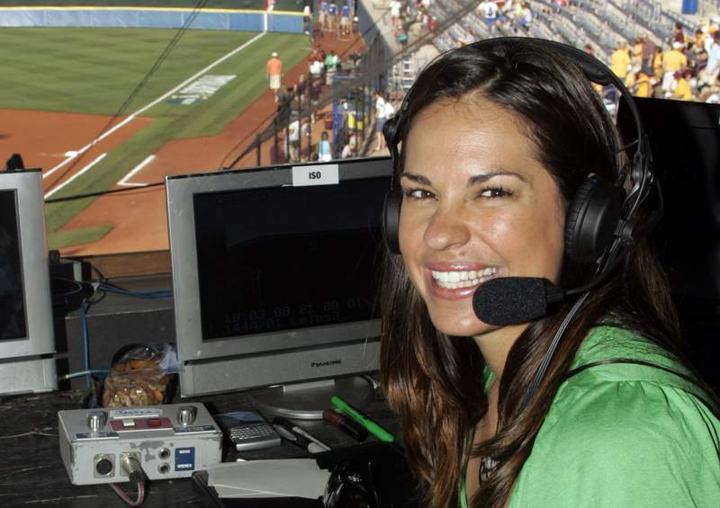 FILE - In this May 29, 2009, file photo, USA softball player Jessica Mendoza poses for a photo in the ESPN broadcast booth at the Women's College World Series in Oklahoma City. ESPN baseball analyst Jessica Mendoza tried to clarify her remarks about the Mike Fiers role in the sign-stealing scandal after criticizing Fiers earlier on a radio show. She said in a statement posted to Twitter that baseball will benefit from the sign stealing being uncovered and that appropriate action was taken. Mendoza's issue remains how it came forward.  (AP Photo/File)