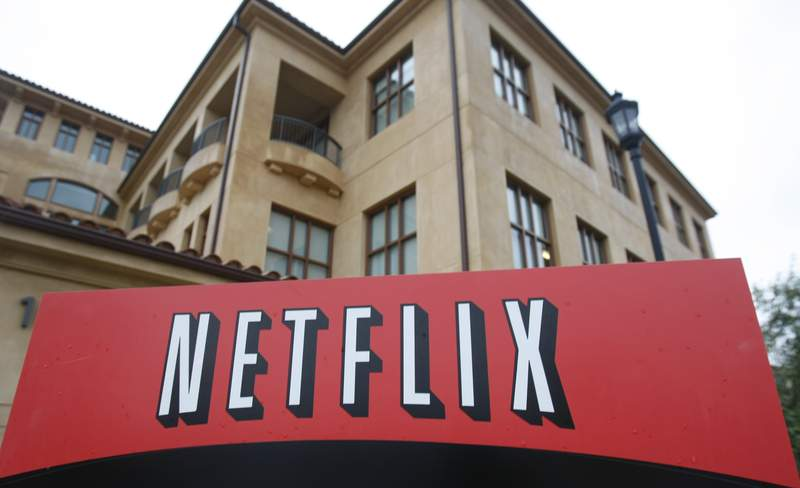 """FILE - This Jan. 29, 2010, file photo shows the company logo and view of Netflix headquarters in Los Gatos, Calif. Netflix's normally lighthearted Twitter account took on a more somber tone on Saturday, May 30, 2020: """"To be silent is to be complicit. Black lives matter. We have a platform, and we have a duty to our Black members, employees, creators and talent to speak up."""" (AP Photo/Marcio Jose Sanchez, File)"""