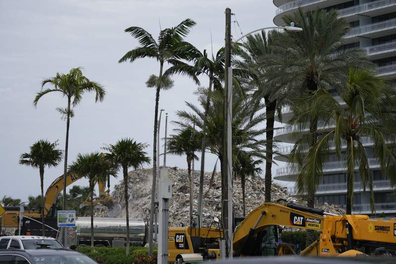 Crews work to clear the rubble of the demolished section of the Champlain Towers South building, as removal and recovery work continues at the site of the partially collapsed condo building, on Monday, July 12, 2021, in Surfside, Fla.