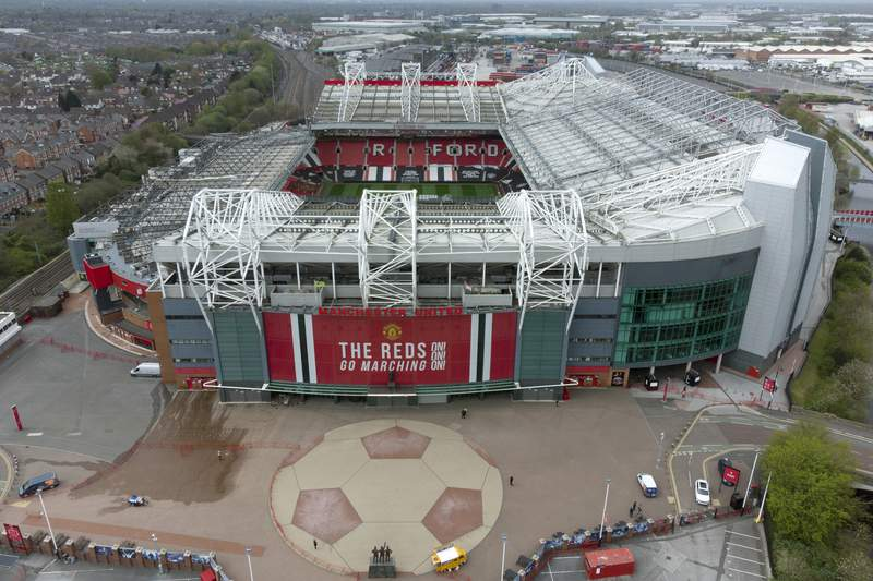 Manchester United's Old Trafford Stadium is seen after the collapse of English involvement in the proposed European Super League, Manchester, England, Wednesday, April 21, 2021. Manchester United executive vice-chairman Ed Woodward will step down from his role at the end of 2021 an announcement which came before Manchester United, along with the other five Premier League sides involved in the proposed European Super League (ESL), withdrew from the competition. (AP Photo/Jon Super)