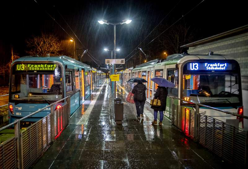 Two women go to a train at a station in Oberursel near Frankfurt, Germany, as rain falls on early Monday, March 15, 2021. (AP Photo/Michael Probst)