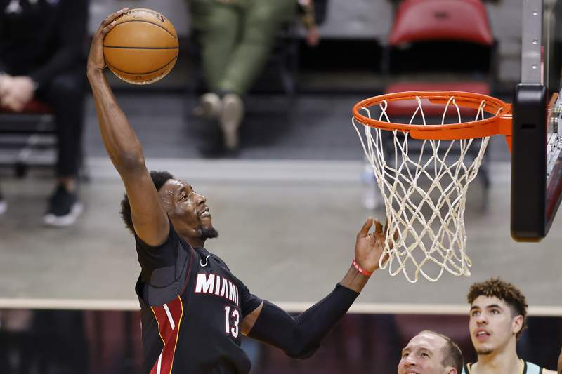 Bam Adebayo of the Miami Heat dunks against the Charlotte Hornets during the fourth quarter at American Airlines Arena on February 01, 2021 in Miami, Florida.