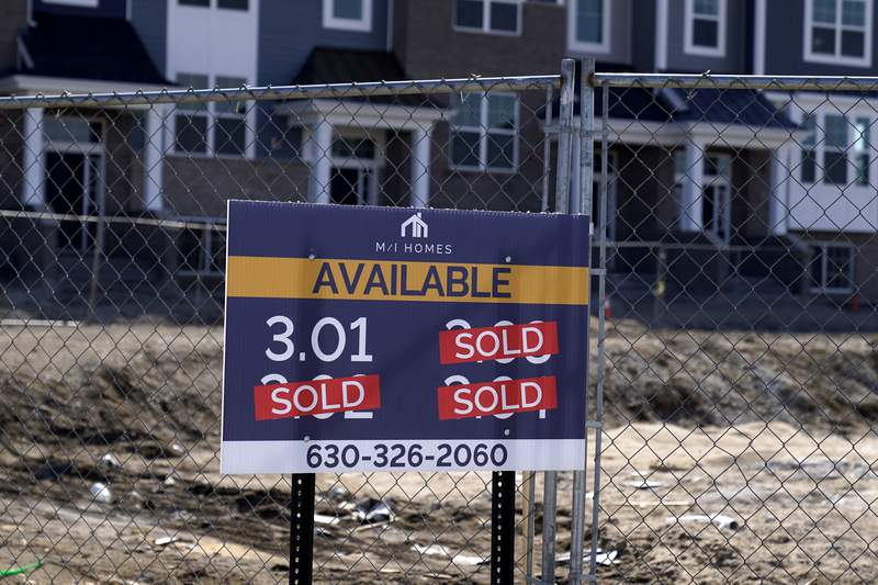 """""""Sold"""" signs are seen on a lot as new home construction continues in a new development in Northbrook, Ill., Sunday, March 21, 2021. On Thursday, May 13, 2021, Freddie Mac reported that mortgage rates declined during the week, marking their fourth consecutive week below 3% and further evidence of the strength in the economys recovery from the pandemic recession. (AP Photo/Nam Y. Huh)"""