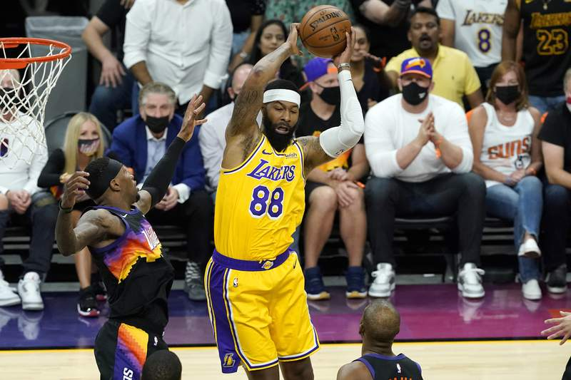 Los Angeles Lakers forward Markieff Morris (88) rebounds against the Phoenix Suns during the first half of Game 5 of an NBA basketball first-round playoff series, Tuesday, June 1, 2021, in Phoenix. (AP Photo/Matt York)