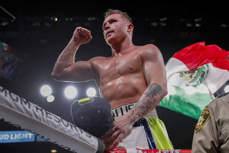 FILE - In this Saturday, Nov. 2, 2019 file photo, Canelo Alvarez celebrates after defeating Sergey Kovalev by knockout in a light heavyweight WBO title bout, in Las Vegas. Alvarez will return to the ring in a world super-middleweight title fight against Britain's Callum Smith on Dec. 19, the boxers announced early Wednesday, Nov. 18, 2020. (AP Photo/John Locher, File)