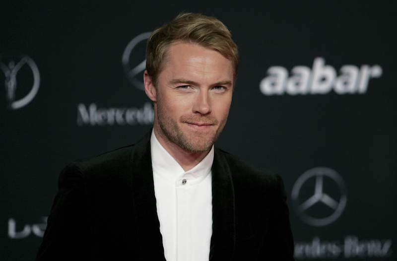 FILE - In this Monday, Feb. 7, 2011 file photo, Irish singer Ronan Keating arrives for the Laureus Awards in Abu Dhabi, United Arab Emirates. Keating has accepted substantial damages from a British tabloid newspaper publisher over phone hacking it was reported on Monday, July 26, 2021. The former member of boyband Boyzone is the latest in a long list of celebrities whose voicemail messages were intercepted by the News of the World more than a decade ago. Keatings lawyer told a High Court hearing that the singer had identified a number of suspicious articles published between 1996 and 2011 which contained his private information. (AP Photo/Nousha Salimi, File)