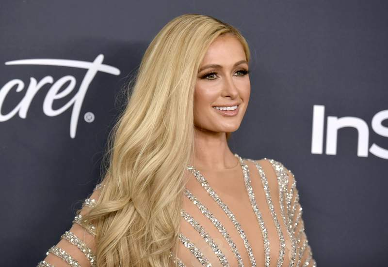 FILE - Paris Hilton arrives at the InStyle and Warner Bros. Golden Globes afterparty on Jan. 5, 2020, in Beverly Hills, Calif. Hilton announced her engagement to entrepreneur Carter Reum in her social media post on Wednesday, Feb. 17, 2021, the same day as her birthday. (Richard Shotwell/Invision/AP, File)