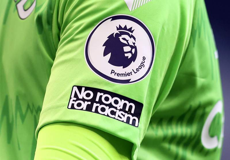 """FILE - This Sunday, Sept. 13, 2020 file photo shows the """"No Room For Racism"""" logo on the shirt of Everton's goalkeeper Jordan Pickford during the English Premier League soccer match between Tottenham Hotspur and Everton at the Tottenham Hotspur Stadium in London. Four days of silence across Twitter, Facebook and Instagram by soccer leagues, clubs and players in England was beginning on Friday April 30, 2021, in a protest against racist abuse that has been adopted more widely. (Cath Ivill/Pool via AP, File)"""